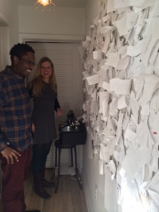 Erin and Randall reading a wall of pages.